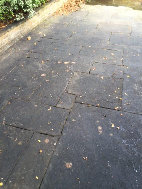 Black Marks on Patio slabs